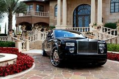 Rolls Royce Phantom in front of a dream home
