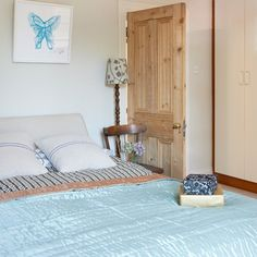 Cream bedroom with pale blue accessories - butterflies