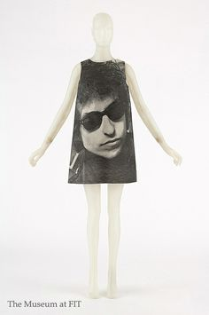 Paper dress with photograph of Bob Dylan by Harry Gordon, paper, black ink, 1968, England, gift of Estelle Ellis.