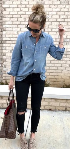 #spring #outfits woman wearing blue denim western shirt, distressed black denim jeans, pair of brown slip-on shoes, and Damier Ebene Louis Vuitton tote bag outfit. Pic by @twopeasinablog