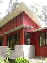 Corrugated Steel Siding Flanked By Red Fiber Cement Board