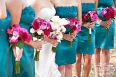 Not the right dresses- but you get the idea.. Teal dresses, pink flowers