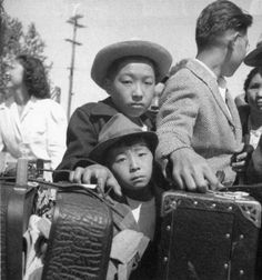 Photograph of Japanese-Americans being relocated to concentration camps in the U.S. during WWI