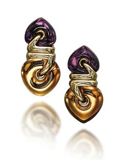 A PAIR OF CITRINE AND AMETHYST EARRINGS, BY BULGARI  Each set with a citrine suspended from an amethyst top, mounted in gold, 3.6 cm, in black leather Bulgari case Signed Bulgari