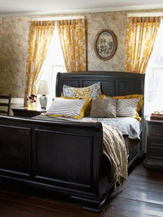 This master bedroom's wallpaper was enlivened by being paired with sunny curtains from Anthropologie.