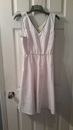 White Star white dress with black trim.  New with tags but has belt loops with no belt.  Size L. $15