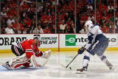 CHICAGO, IL - JUNE 15: Corey Crawford #50 of the Chicago Blackhawks makes a save against Steven Stamkos #91 of the Tampa Bay Lightning during the second period in Game Six of the 2015 NHL Stanley Cup Final at the United Center on June 15, 2015 in Chicago, Illinois. (Photo by Bruce Bennett/Getty Images)