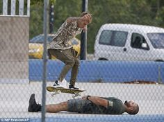 Precarious: In the absence of a jump, Justin Bieber used a friend for a skateboard jump in Ibiza on Monday