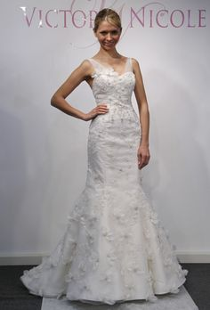 Brides: Victoria Nicole - Spring 2013. Sleeveless satin mermaid wedding dress with sheer tulle straps and all-over beaded organza flower details, Victoria Nicole