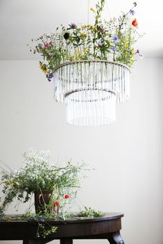 looks like a crystal chandelier, but is actually made from chemistry test tubes placed into circular plywood bands. SO many different design possibilities!