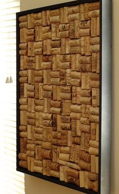 Either a piece of art or a cork board. Get a deep enough picture frame so you can use whole corks instead of cutting them, and glue gun them in in whatever pattern suits you. Awesome.