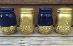 Set of 4 Glitter Mason Jars - Use for Makeup Brushes, Pens, Wedding Centerpieces, Baby Shower, Bridal Shower, Navy Blue and Gold Jars, Vases by PrettySimplyStudio on Etsy https://www.etsy.com/listing/234254450/set-of-4-glitter-mason-jars-use-for