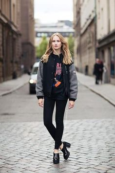 trending: the varsity jacket - oversized varsity jacket worn with a graphic t-shirt, black skinny jeans, and chunky mules