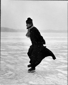 Catholic priest ice skating. Photograph by John Dominis. Detroit, Michigan, 1955.