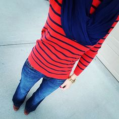 Casual outfit idea - a striped sweater with flared jeans, a scarf, and booties