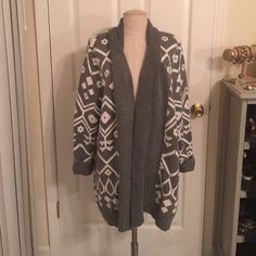 Tribal Cardigan Sweater Heavy knit tribal print cardigan sweater. Gently worn and in great shape. Some pilling in contact areas (will double check and remove any pilling before shipping out). Thick and warm! I used this in lieu of a coat some cold days. ❤️Bundle to save!❤️ Old Navy Sweaters Cardigans