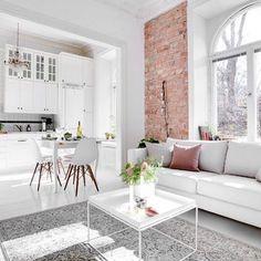 White home, exposed brick