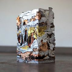 Jewelry, sculpture, and objects by artist MJ Tyson made from reconstituted and melted metal.