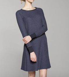 Crafted with the softest waffle-knit fabric, this casual dress is comfy and cozy for everyday wear. It's cut slim on top, to layer under sweaters, jackets and vests come winter, and the skirt flares into an a-line silhouette below the waist.