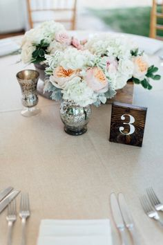 White, Peach and Green Centerpiece With Wooden Table Numbers | A Rustic & Romantic Atlanta Wedding via TheELD.com | Edge Design Atlanta and Justen Clay Photography