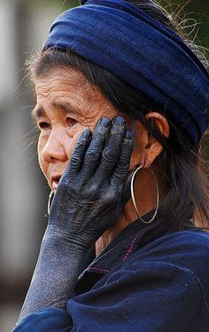 Hmong tribe women hand colored by the blue dye they use for their textiles.