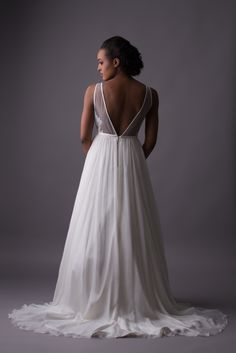 back of Emerick from Emmaline Bridal. lace scallops edge the low illusion open back on this romantic wedding gown. #lacescallops #openbackweddingdress #sheerbackweddinggown #weddinggown #romanticwedding