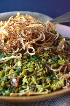 A Middle Eastern comfort dish of Basmati rice and lentils, piled high with fried onions
