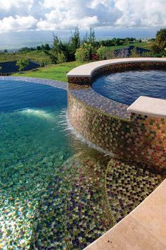 Glass tile - a luxurious pool finish choice can take a big initial financial investment but I am sure it's worth it!