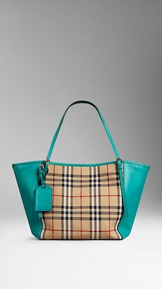 The Small Canter in Horseferry Check and Leather from Burberry - A tote bag in jacquard-woven Horseferry check with side panels crafted in smooth leather. Inspired by vintage designs, the bag features a leather luggage tag and buckled straps, while the open top closes with a stay fastening and magnetic press-stud. Discover the women's bags collection at Burberry.com