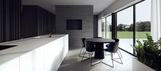 The first design is a house located in Torun, a city in northern Poland along the Vistula River. The majority of the interior is done in deep gray, black, and blinding white. The resulting space is certainly sleek but manages to create its own energy.