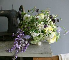 I love the floral arrangement...but I really want that old sewing machine!