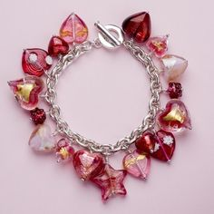 Hand Made Murano Glass and Bohemian Glass Bead Stirling Silver Charm Bracelet in presentation box.    Beautiful jewellery handmade in London by professionally trained Jewellers for Martick Jewellery.