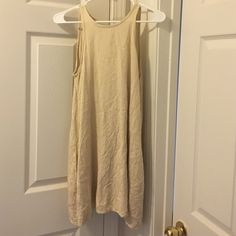 ALTERNATIVE cream dress needs new button on the back because I asked my husband to undo it one day after wearing it :'( boys are so dumb! But it's an easy fix. Has pockets! :) minor wear. Let me know if you have questions. Has extra button sewn on inside!! 100% RAYON Alternative Apparel Dresses