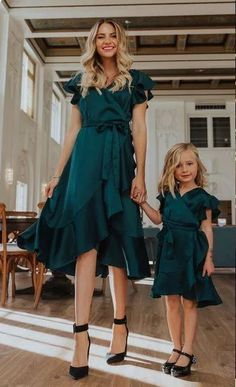 Mother + Daughter Matching Green Christmas Party Dress | Looking for classy Christmas party outfits ideas?  Get chic and formal holiday party dresses, chic Christmas skirts and Xmas holiday pants with sequin sparkle. Get ideas for pretty Christmas outfit and Christmas classy style. Perfect for winter and the 2020 holiday season. #christmaspartyoutfits #christmasoutfitideas #classychristmasoutfits #holidayoutfits
