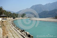 Photo about An image of the large Ganges River in north India as it winds out of the Mountains towards the plains of India. Image of ganga, banks, plains - 90146623 North India, Boarders, Walkway, Teal Blue, Gazebo, River, Stock Photos, Mountains, Outdoor Decor
