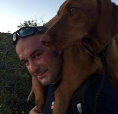 Spooked by fireworks, a #Vizsla named #Rue escaped from her Salt Lake City yard and became stranded on a mountain ledge three miles away. Firefighter Tony Stowe carried the injured dog back down the mountain. #hero