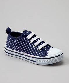 Perfect for playtime, this classic sneaker will fuel the fun all day long. A sturdy toe cap and sweet polka dot design come together to create a simply styled shoe that's long been a favorite among little feet.Cotton / canvas upperRubber soleImported