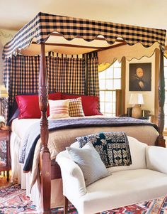 Four Poster Bed with check pattern canopy and hangings