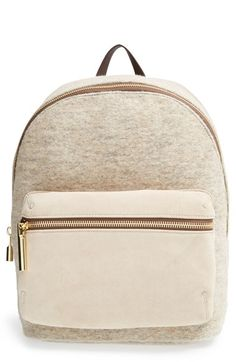 Free shipping and returns on Elizabeth and James 'Cynnie' Suede & Wool Backpack at Nordstrom.com. Lush textures and muted colors make this double-faced wool and suede backpack from Elizabeth and James so covetable for the cooler seasons. A convenient exterior zip pocket keeps your small essentials close at hand, while a spacious interior and deep wall pocket will easily accommodate your tech and larger gear. Soft lambskin leather adjustable straps allow for hands-free portability.