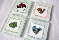 Cross Stitch Coasters. I don't want to do Pokemon coasters, so this is just a reminder about cross stitch in coasters.
