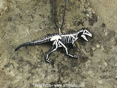 http://sosuperawesome.com/post/152358564923/painted-resin-skeleton-necklaces-by-aelia-petro-on