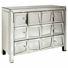 Perfect for stowing cashmere sweaters in your master suite or spare linens in the guest room, this eye-catching chest showcases a mirrored front and 3 drawer...