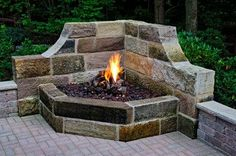gas-powered fireplace sits in the corner of a patio to give optimum light and heat to the area and provide lovely ambiance.This gas-powered fireplace sits in the corner of a patio to give optimum light and heat to the area and provide lovely ambiance. Backyard Fireplace, Fire Pit Backyard, Backyard Patio, Outdoor Fireplaces, Corner Fireplaces, Fire Pit Furniture, Traditional Landscape, Backyard Projects, Outdoor Landscaping