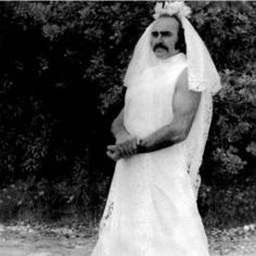 I found this picture of Sean Connery with a horseshoe mustache dressed in a female wedding dress, wtf is this? I think it is from the movie Zardoz but was Connery trolling or something? looks off stag Sean Connery, Weird Vintage, Sexy Wedding Dresses, Wedding Film, Wedding Wear, Fall Wedding, Scene Photo, Wedding Videos, Rare Photos