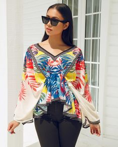 Image may contain: 1 person, standing and sunglasses American Women, American Lady, Chic Couture Online, Sunnies, Sunglasses, Chelsea, Kimono Top, Blouse, Jeans
