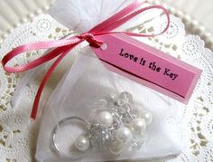 Cute keychain for a wedding shower favor. This is a possibility! Maybe handmade?