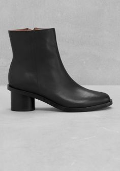 Crafted from smooth goat leather, this ankle boot features a sophisticated clean vamp and a rounded block heel.