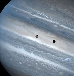 Io Transit of Jupiter The three snapshots of the volcanic moon rounding Jupiter were taken over a 1.8-hour time span. Io is roughly the size of Earth's moon but 2,000 times farther away. J.Spencer(Lowell Observatory)& NASA/ESA