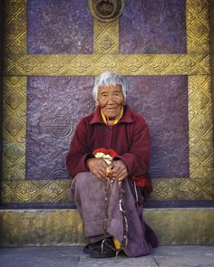 """Photo by @alisonwrightphoto // To earn good merit Samten, an eighty-two-year old Buddhist nun, circumambulates around Kamsun Yuly Namgyal Monastery in Punakha Valley, Bhutan every day. Published in my book """"Face to Face: Portraits of the Human Spirit."""" This photo was taken during one of my #Nationalgeographicexpeditions photo tours while working as a Southeast Asia expert leader.  I have two new trips coming up in 2016, the first one in April. Please visit their website to find out more…"""