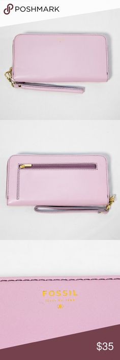 New pink Fossil wallet Brand new with tags pink Fossil accordion wallet with three-side zipper, wrist band, and zippered pouch on the back.  Color: Pink, teal interior, gold hardware Dimensions (w h): 8 x 4.25 inches Fossil Bags Wallets